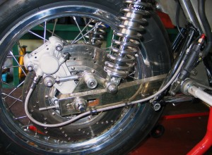 Rear brake adapted to take twin pot caliper