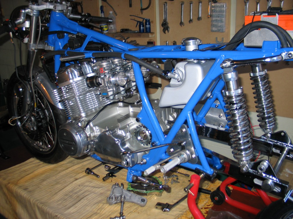 Things starting to come together. Engine in, front end on, oil tank in, battery in, shocks mounted, and swinging arm in.