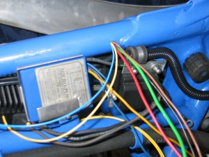 Front exit for the wiring loom near the ignition box.