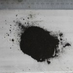 """Black dust caused by break down of petseal """"found in carb bowl""""."""
