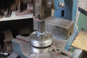 shell being pushed on using puller