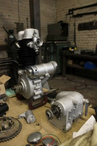 Refurbished BSA C11 1939 engine and gear box amongest other restored parts.